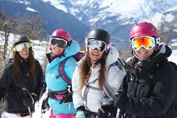 telemark skiers in a group lesson image of
